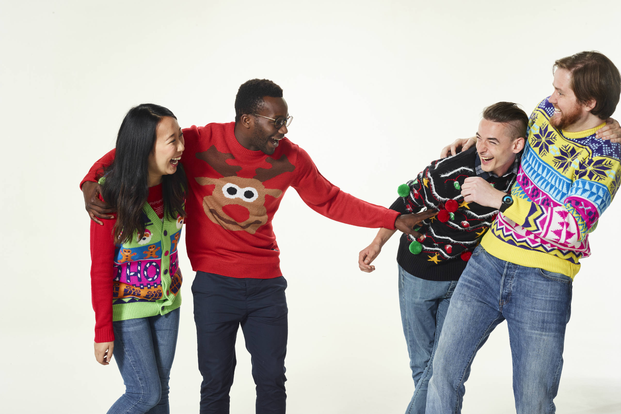 A group of friends pose in their jumpers