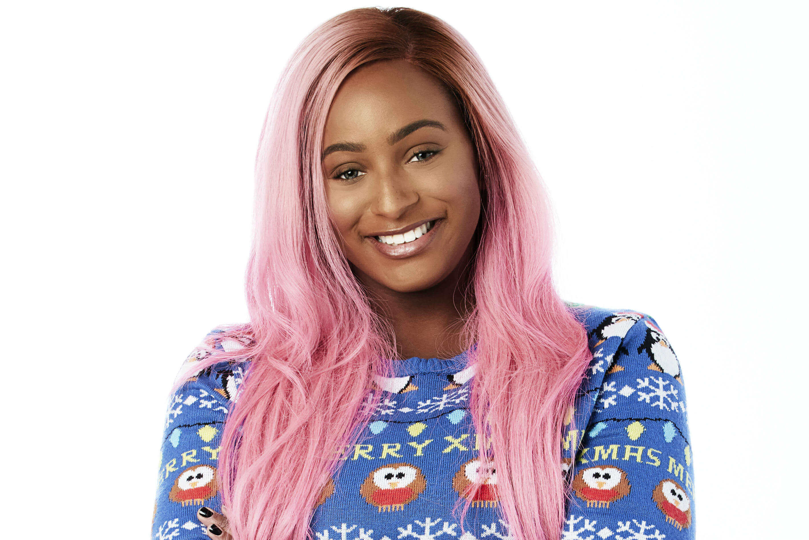 DJ Cuppy, wears a festive Christmas Jumper in support of Save the Children