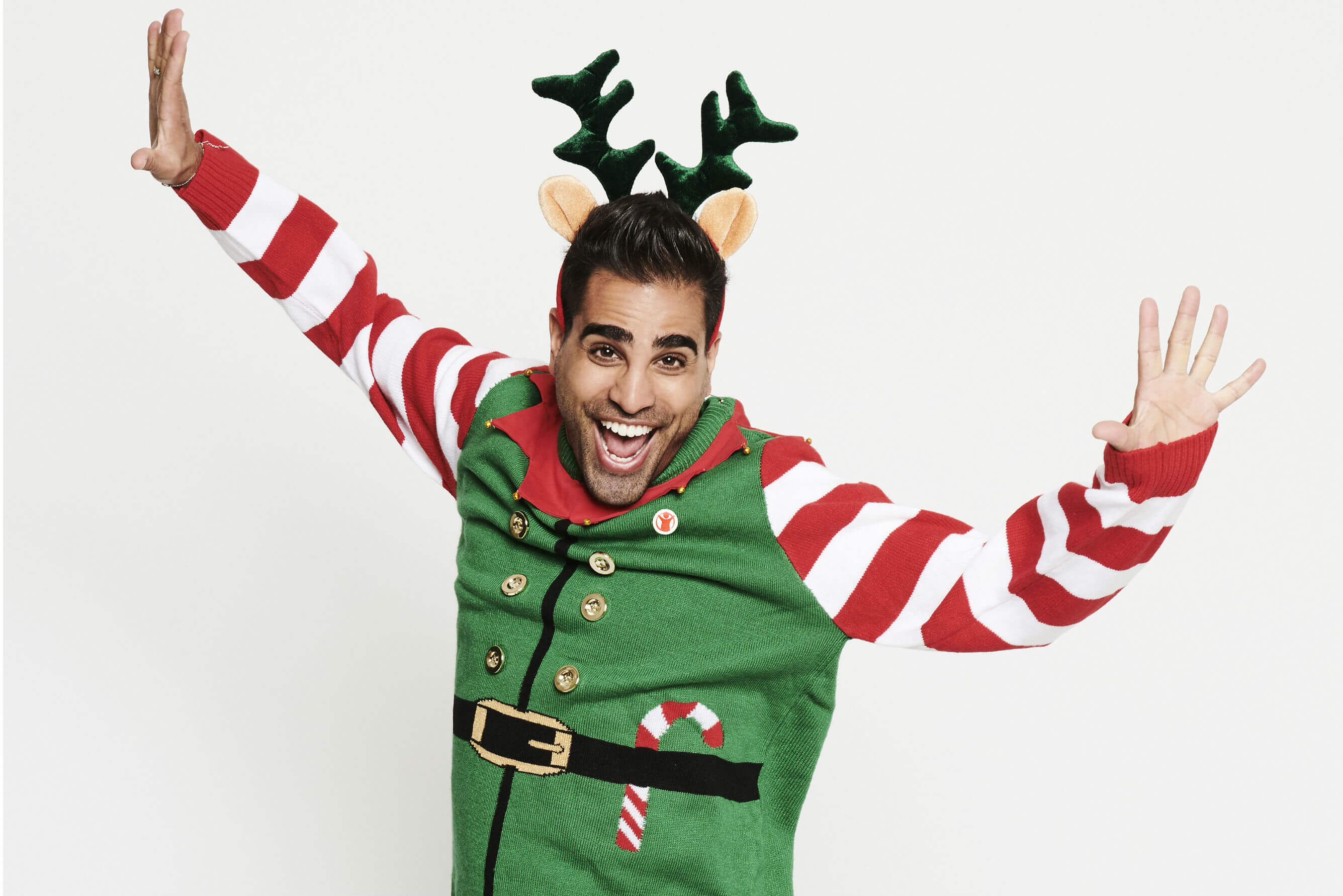 Dr Ranj puts on his Elf Christmas Jumper and reindeer ears for Save the Children's Christmas Jumper Day.