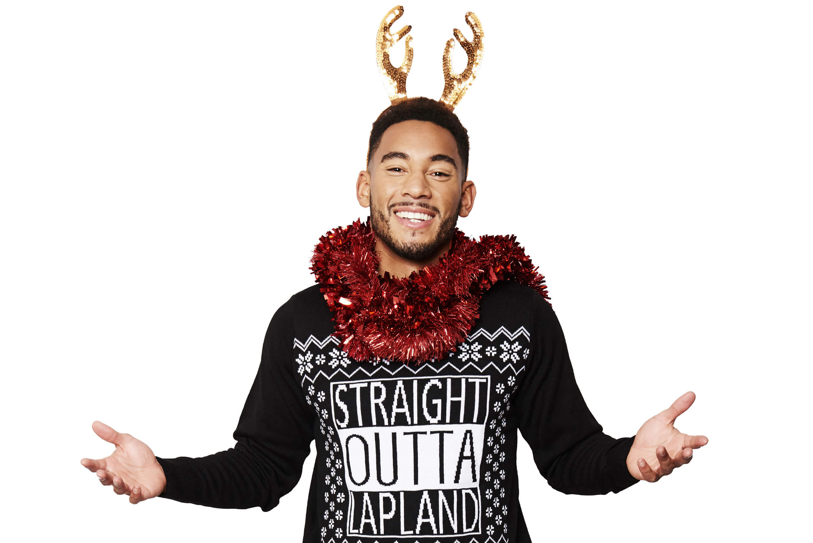 Love Islands Josh Denzel puts on his Christmas Jumper for Save the Children's Christmas Jumper Day.