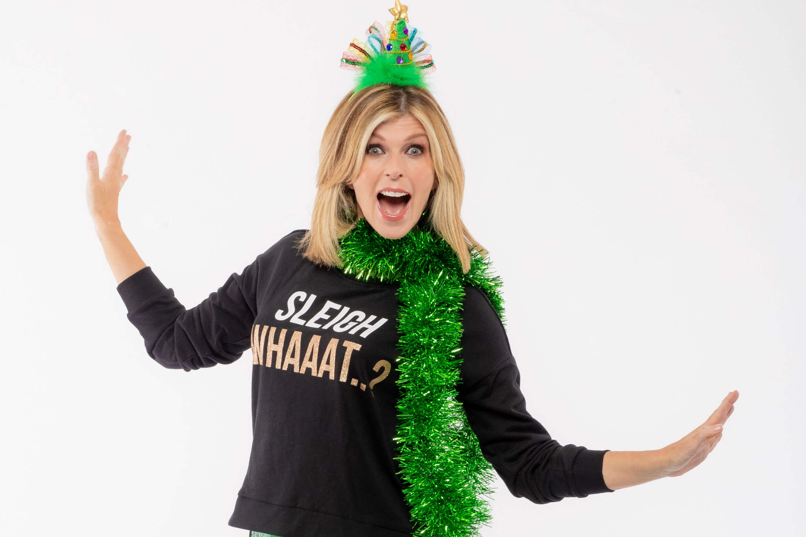 Kate Garraway puts on her Christmas Jumper for Save the Children's Christmas Jumper Day.
