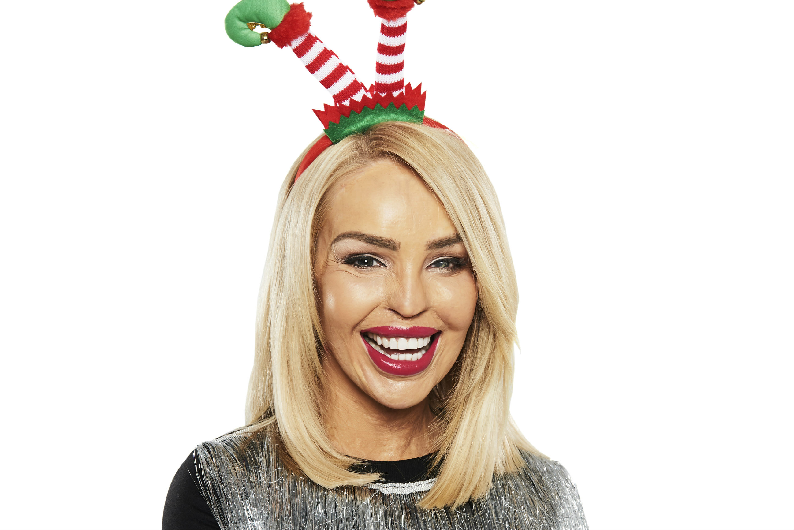 Katie Piper wearing elf ears and her sparkly festive jumper for Save the Children's Christmas Jumper Day