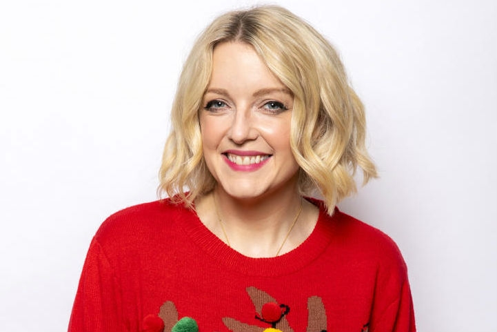 Lauren Lavern wears her red festive jumper and for Save the Children's Christmas Jumper Day.
