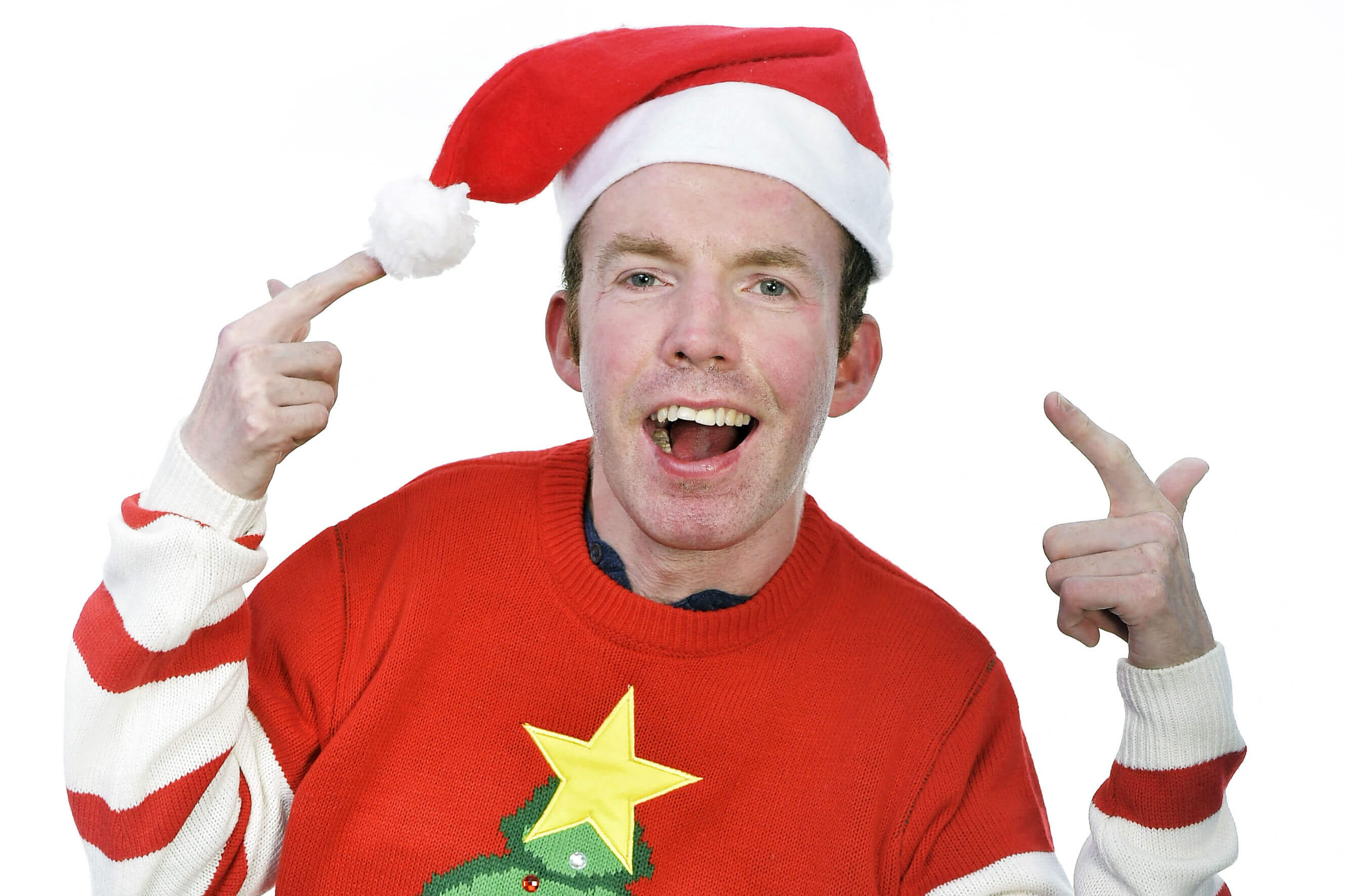 Lee Ridley wears his red festive jumper and santa hat for Save the Children's Christmas Jumper Day.