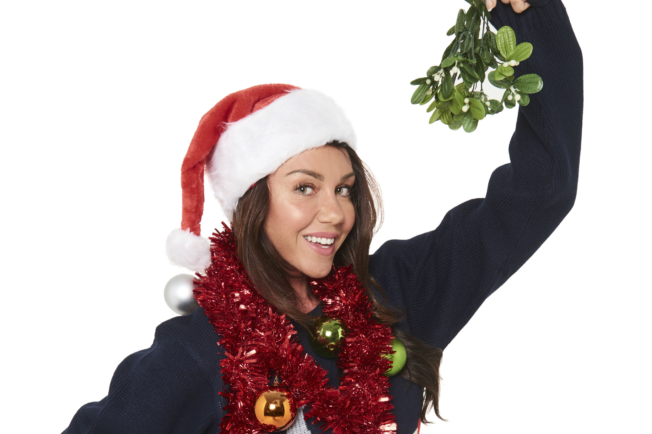 Michelle Heaton, wears tinsel and her festive Christmas Jumper for Save the Children