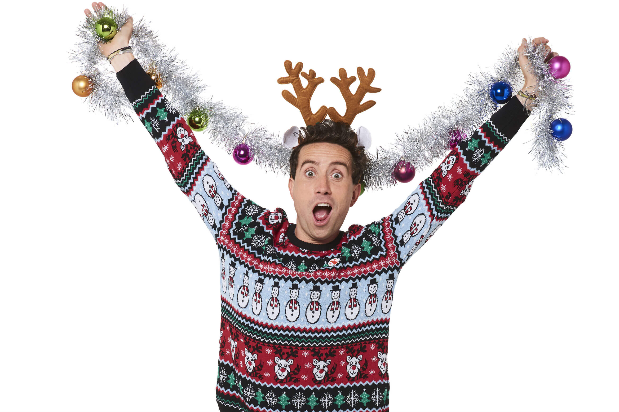 Radio presenter Nick Grimshaw, wears tinsel and his festive Christmas Jumper for Save the Children