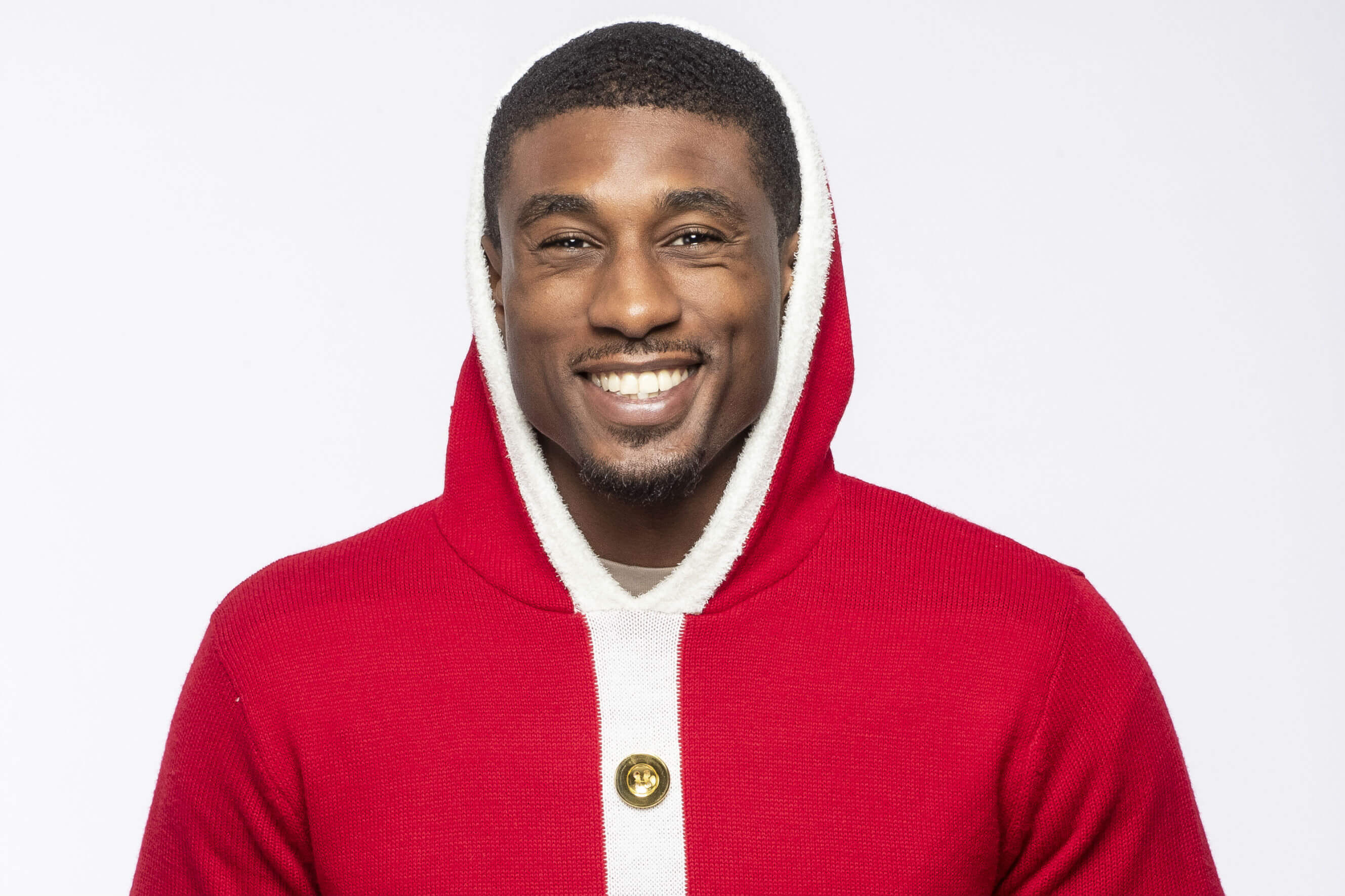 Love Islands Ovie puts on his Christmas Jumper for Save the Children's Christmas Jumper Day.