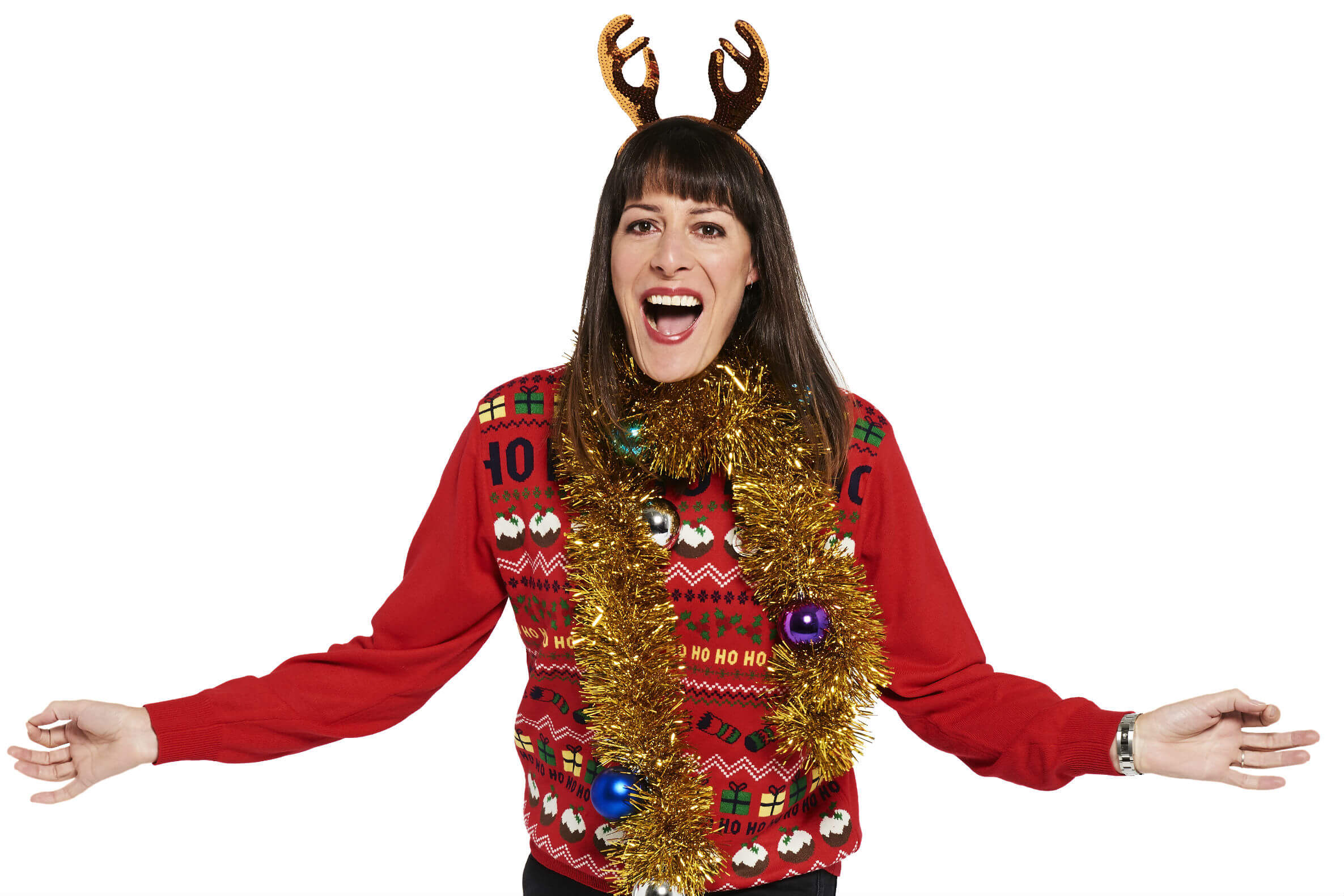 Rebecca Root, wears tinsel and her festive Christmas Jumper for Save the Children