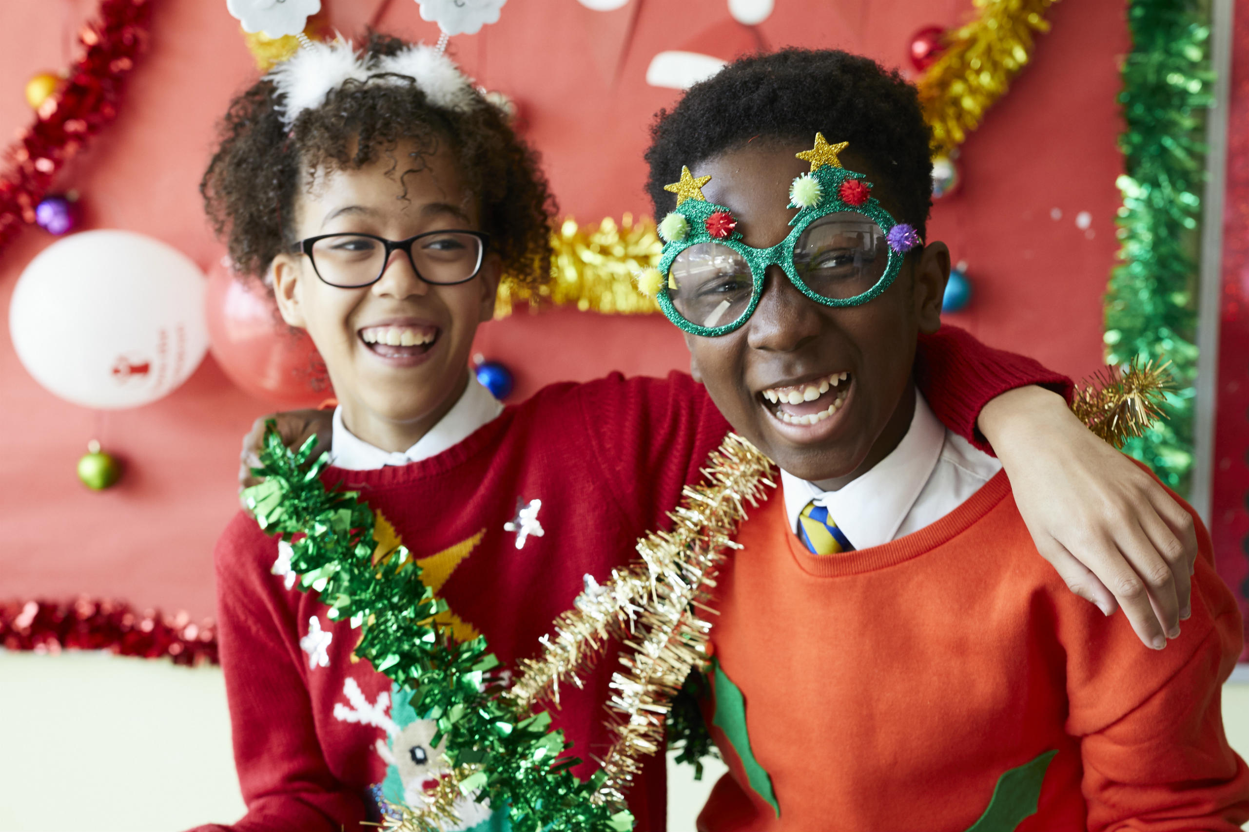 Secondary school children enjoying their Christmas Jumper Day activities at school