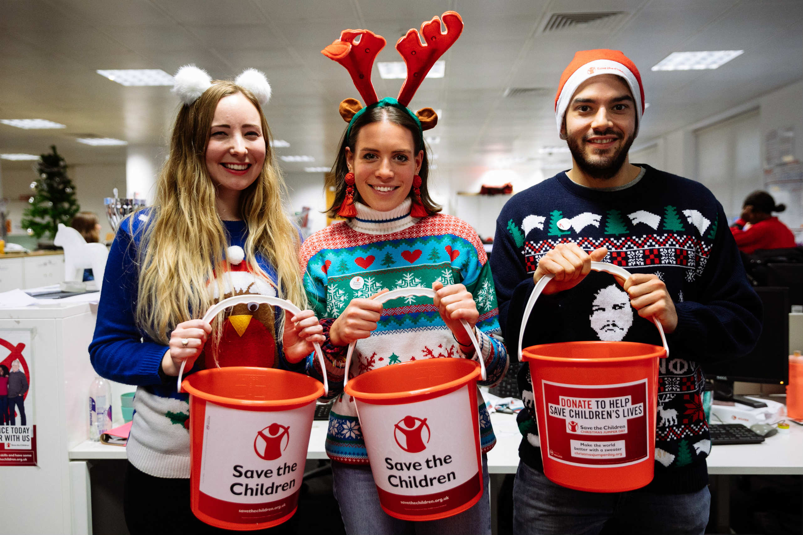 Office workers collecting donations on Christmas Jumper Day