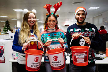 Office workers collect donations for Christmas Jumper Day