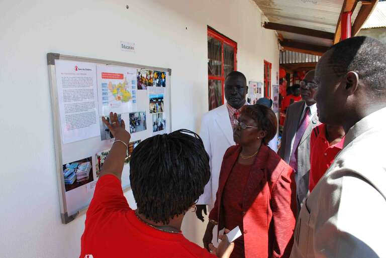 Rose Wahome, Education Project Manager, shows the Minister some of the work we are doing across the country
