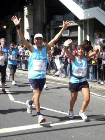 Emma and David running the British 10K for Save the Children