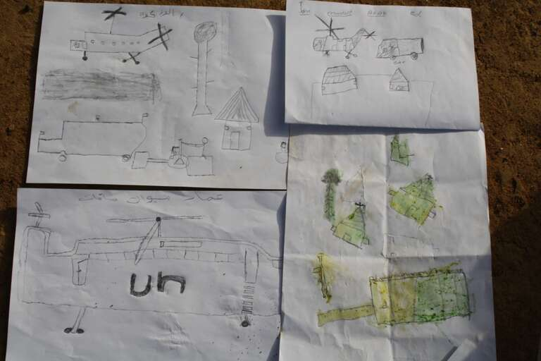 Children's drawings from the Save the Children CFS in Mayen Abun.