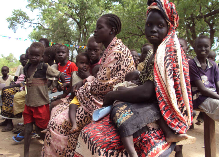 Mothers and children wait to be registered for assistance in Wunrok, southern Sudan.