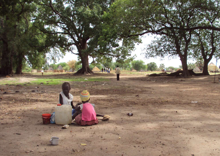 Children wait to be reunified with their families in Wunrok, southern Sudan.