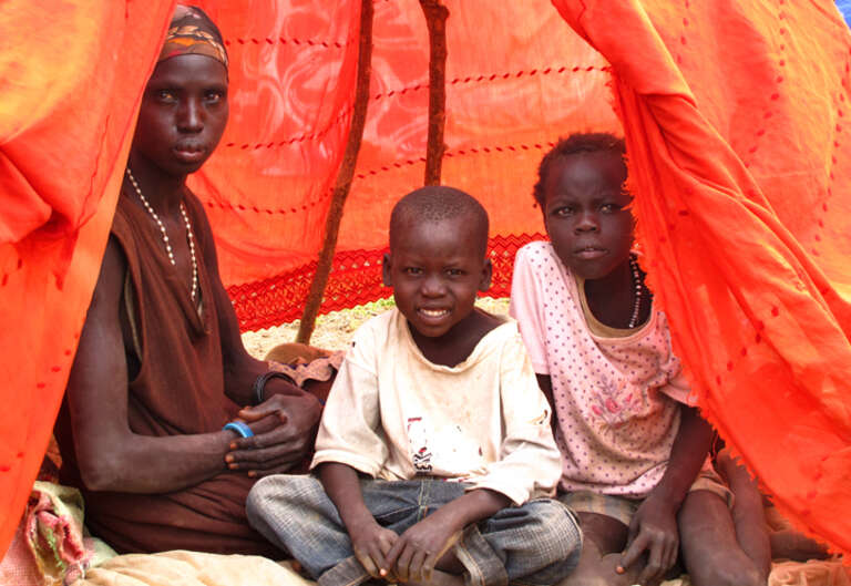 Mother with her children in Akak, southern Sudan.