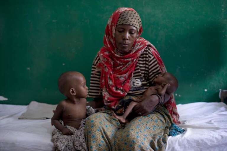 Faouma with 4 month old Aisha and 1 year and 9 month old Mohammed - brother and sister both being treated at Bosaso stabilisation clinic for children suffering from severe acute malnutrition with medical complications.
