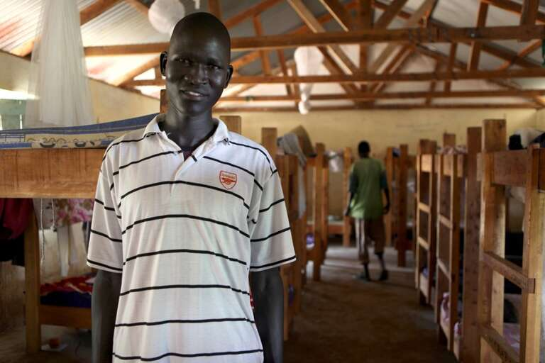 Carpentry instructor Emmanuel Yak Bol is a former student at the Technical and Vocational Education Training (TVET) Centre. His graduating class built the bunk beds in their dormitory. The TVET Centre in Malualkon Boma, Aweil East County has been open since 2004, targeting school dropouts and orphaned children, regardless of the level of education they have attained. The Centre offers courses in Agriculture, Carpentry, Masonry and Tailoring.