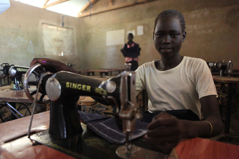 Tailoring student Angelina (Sandy) Arop, 14, practices sewing a school uniform at the Technical and Vocational Education Training (TVET) Centre.