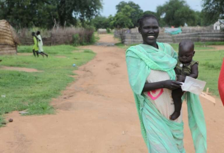 Tereza walks straight to the market after receiving her monthly 80 SSP from Save the Children.