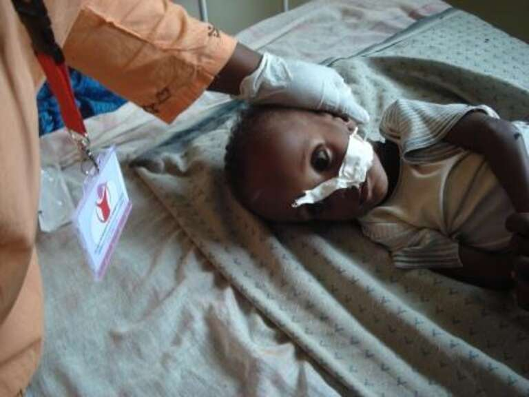 a recovering baby Osman at the stabilization centre