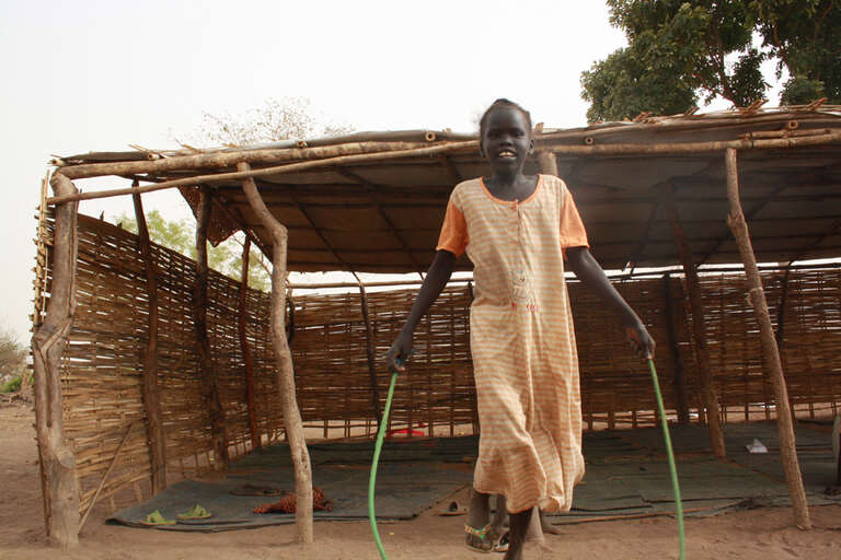 Rebecca skipping rope in Barial IDP camp.