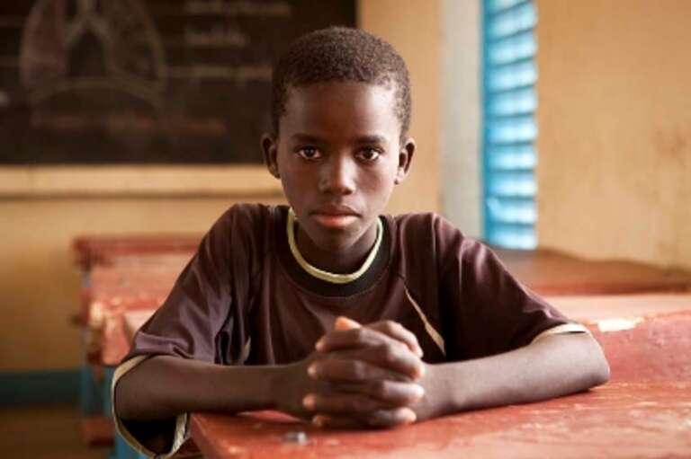 A ten-year-old boy at school in Niger