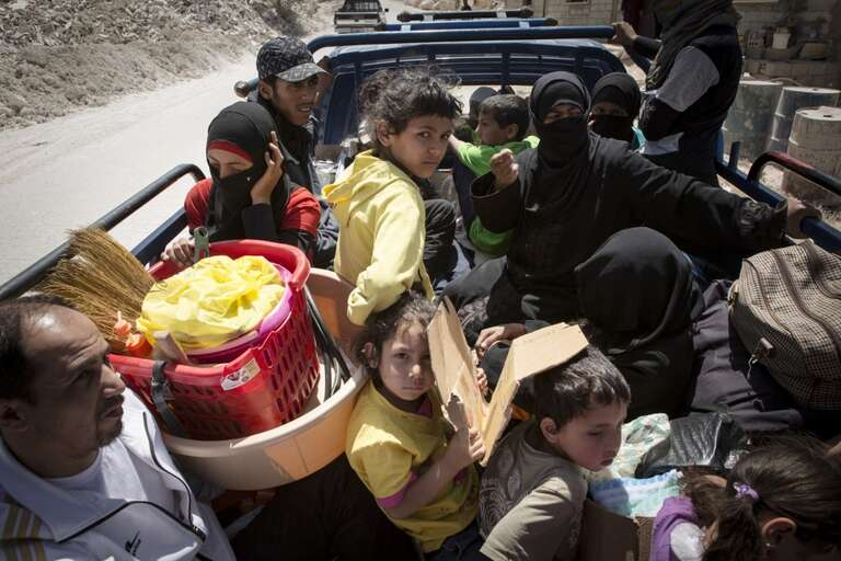 Refugees cross the Syria border, without knowing where they will end up