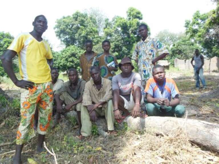 Ntiba boys at the spot where a soldier was killed, sparking rebel vengeance