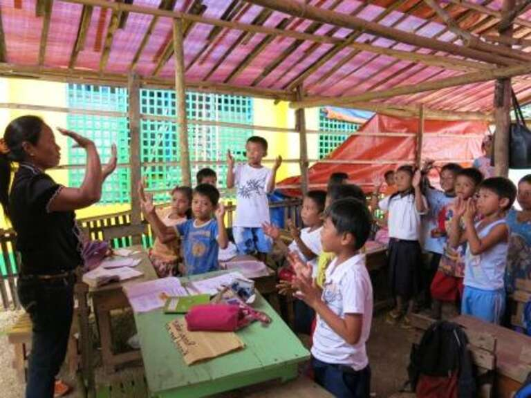 Leliosa teaches her class in the badly hit community of Santa Cruz