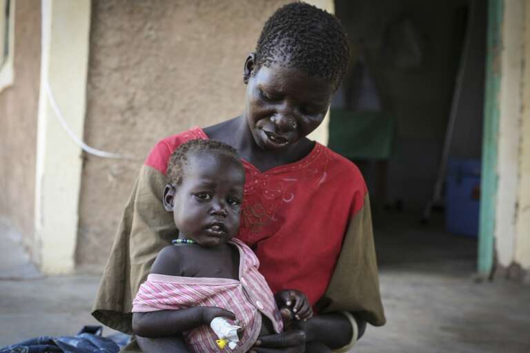 Afisha and her child Sarah, who is being treated for cholera at a Save the children-supported health centre