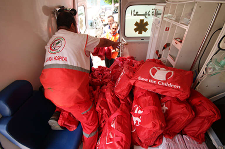 Save the Children medical supplies being loaded on to an ambulance in Gaza