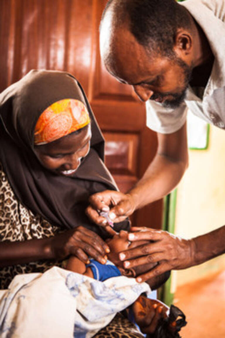 Five-month-old son Muhsin is vaccinated at a health centre in north east Kenya.