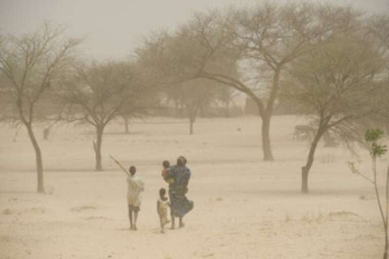 A family in Niger returns home from their fields.