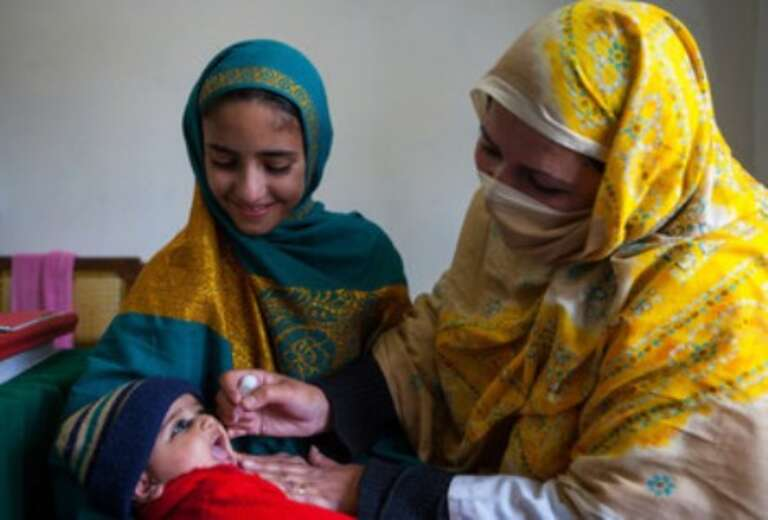 Four-month-old Umesa, from Battagram in Pakstan, is given polio drops.