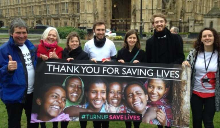 Save the Children campaigners celebrate outside Parliament yesterday.