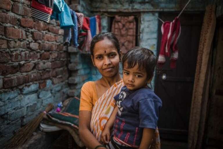Rekha, from Delhi, with Rishabh. Rekha lost a child to diarrhoea.