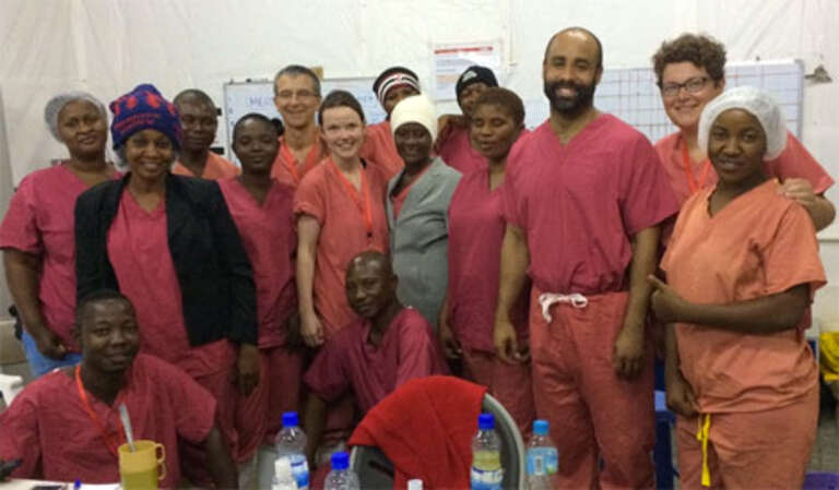 Dr Warrell with the rest of her international team at the Kerry Town Ebola treatment centre