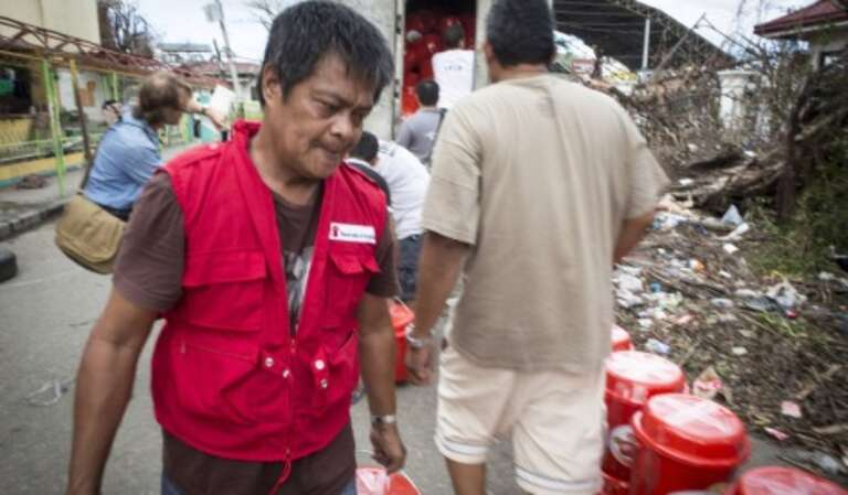 A Save the Children aid worker in the response to Typhoon Haiyan in 2013.