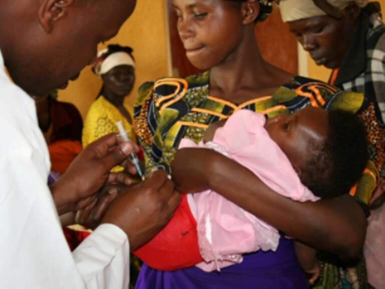 A baby girl is vaccinated in a clinic in Rwanda