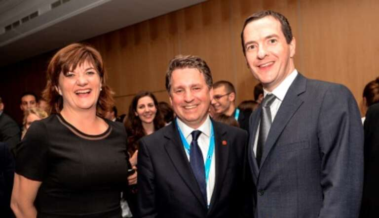 Save the Children CEO Justin Forsyth (centre) is joined by Education Secretary Nicky Morgan and Chancellor George Osborne at the Conservative Party Conference
