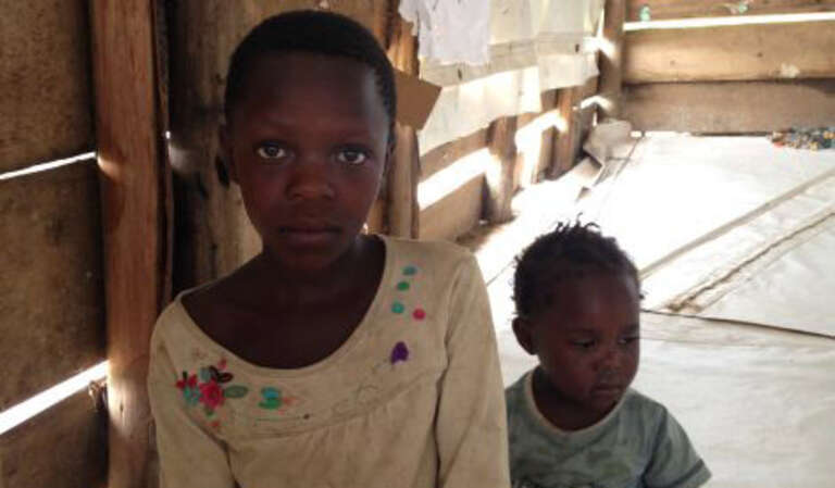Ten-year-old Blessed and her sister, Gloria, face an uncertain future in the Rwamwanja refugee camp.