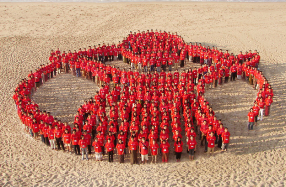 People in Myanmar gather to make up a human Save the Children 'Charlie Brown' logo in 2008.