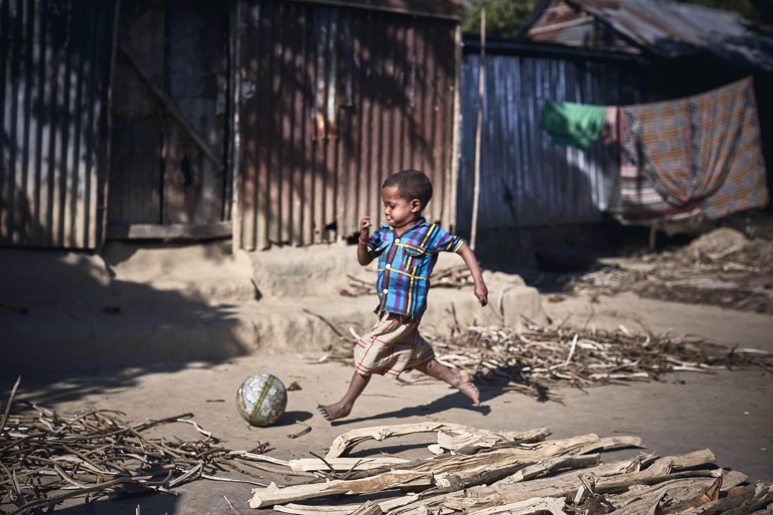 Nirob plays football in his village in rural Bangladesh.