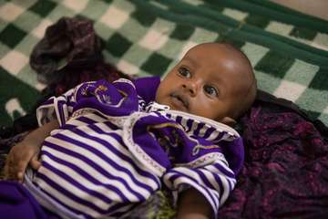 Ade, five-months-old, was brought in by her mother Awia, at a stabilisation centre in Ethiopia.