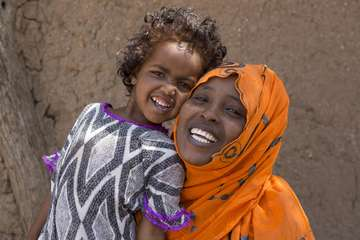 Madan, a survivor of FGM and now campaigner, and her daughter.