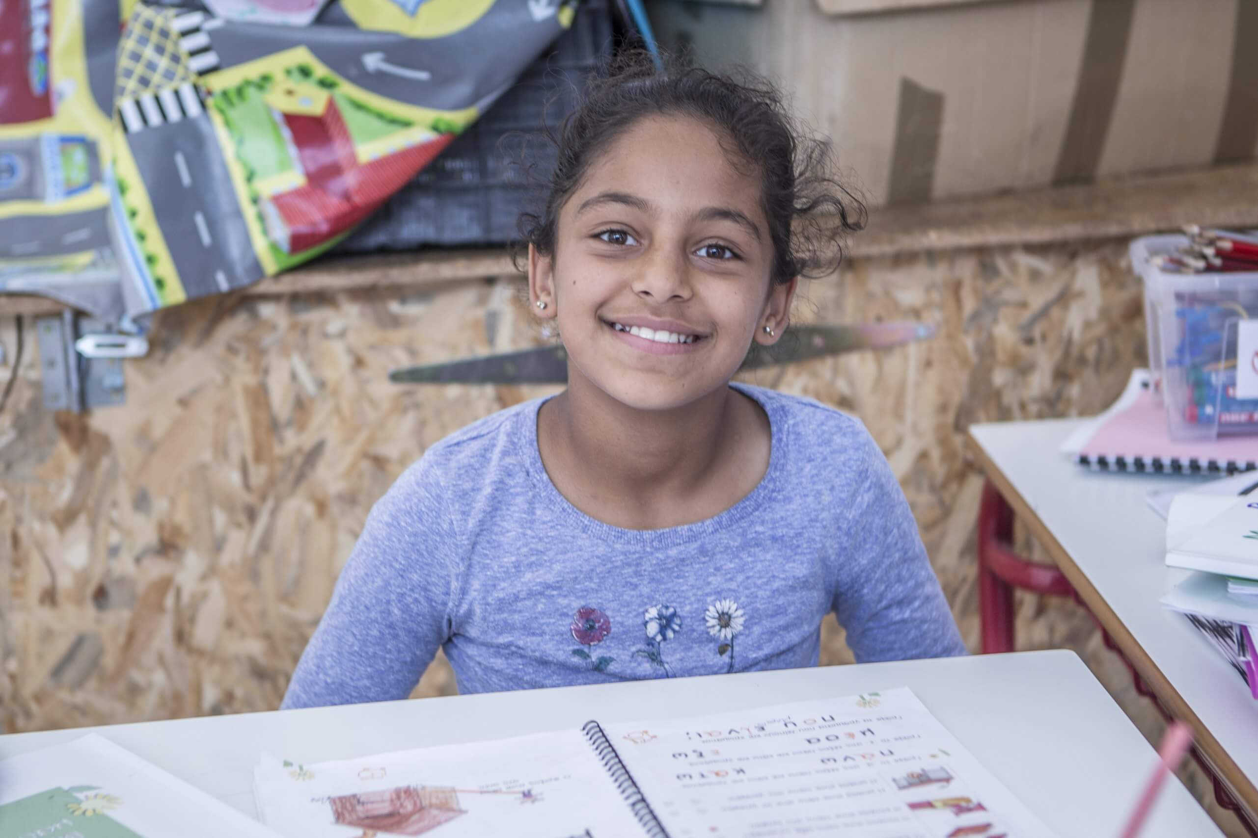 Smiling girl who is a child refugee in Greece