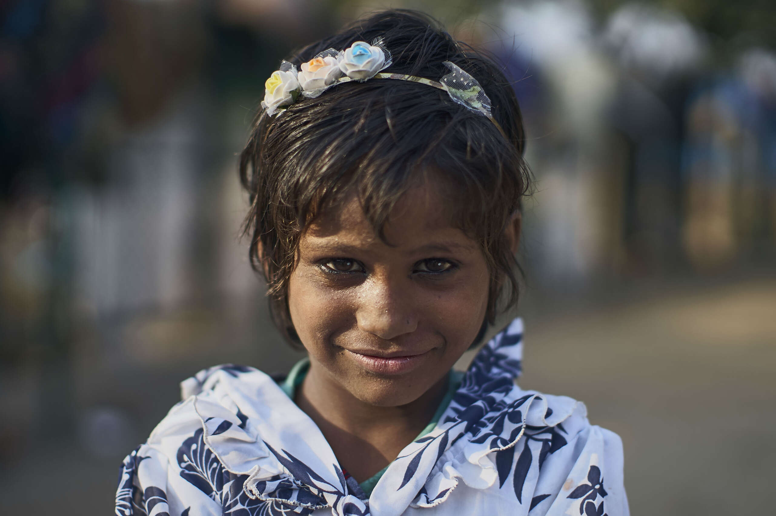 Meera,  one of 6 siblings, lives in a large marketplace in Delhi, India with her mother and her two younger sisters.