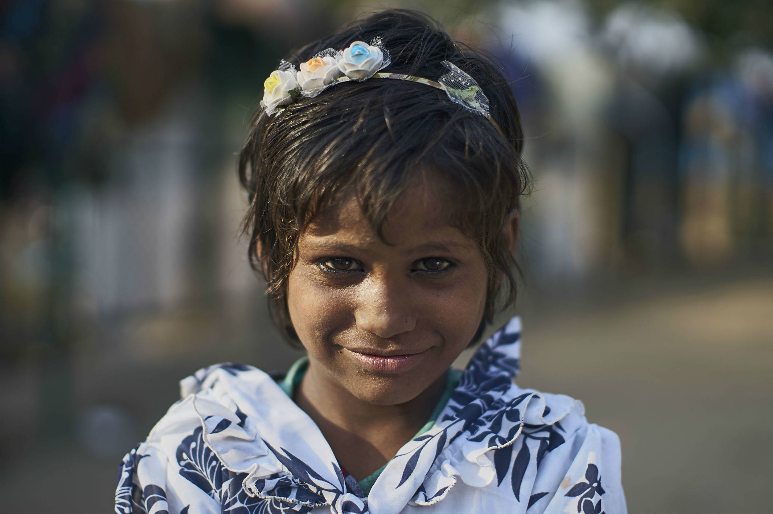 Meera lives in a large marketplace in Delhi, India with her mother and her two younger sisters